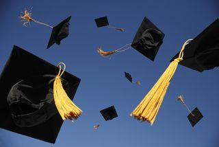 Graduation-hats-flying1